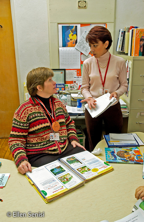 MR / Schenectady, NY.Yates Arts in Education Magnet School, Grade Two.Reading resource teacher (standing) talks with teacher in classroom. Resource teacher takes lower achieving students out of the classroom several times a week for reading help..MR: Car19 .© Ellen B. Senisi