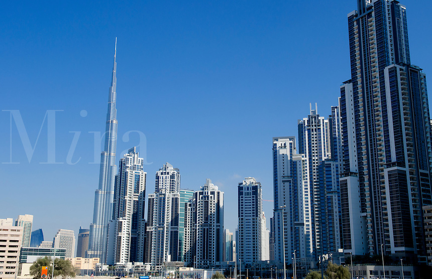 Construction and new skyline of amazing Dubai UAE with the world's tallest building Burj Khalifa at 2722 feet and 162 stories in thriving new United Arab Emirates in Middle East in Gulf States