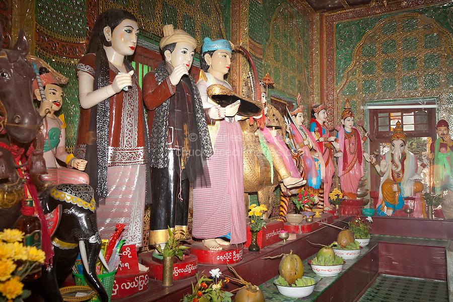 Myanmar, Burma.  Shrine to Local Nats (Spirits), Mount Popa Monastery.  Hindu God Ganesh on far right.