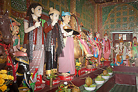 Myanmar, Burma.  Shrine to Local Nats (Spirits), Mount Popa Monastery.  Hindu God Ganesh on far right.