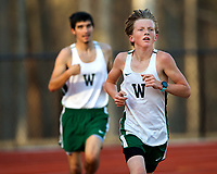 Photography of the Woodlawn School track team on running in the first every tack meet held on the new track at Woodlawn School in Davidson, NC.<br /> <br /> Charlotte Photographer - PatrickSchneiderPhoto.com