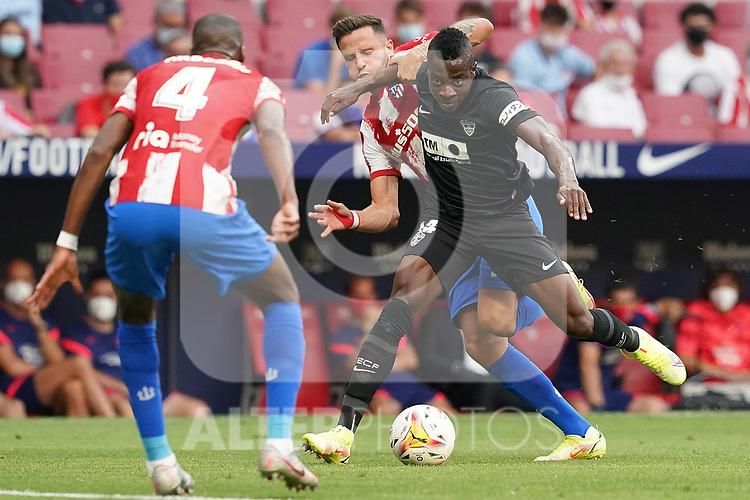 Atletico de Madrid's Geoffrey Kondogbia (l) and Saul Niguez (c) and Elche CF's Helibelton Palacios during La Liga match. August 22,2021. (ALTERPHOTOS/Acero)