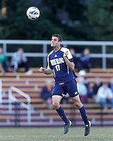 University of Rhode Island (URI) defender Robby Gargaro (17) heads the ball. Boston College defeated University of Rhode Island, 4-2, at Newton Campus Field, September 25, 2012.