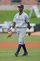 Shortstop Tim Beckham #22 of the Charlotte Stone Crabs walks out to his defensive position at Roger Dean Stadium June 15, 2010, in Jupiter, Florida.  Photo by Brian Westerholt /  Seam Images