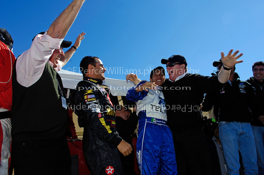 (L to R): Felix Sabates, Juan Pablo Montoya, Salvador Duran and Chip Ganassi react as Scott Pruett crosses the finishline to win the 24 Hours.