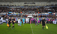 Teams led by match officials exit the tunnel during the Premier League match between Swansea City and Sunderland at The Liberty Stadium, Swansea, Wales, UK. Saturday 10 December 2016