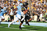 CHAPEL HILL, NC - SEPTEMBER 21: Zac Thomas #12 of Appalachian State University outruns Tyrone Hopper #42 of the University of North Carolina and scores a touchdown during a game between Appalachian State University and University of North Carolina at Kenan Memorial Stadium on September 21, 2019 in Chapel Hill, North Carolina.