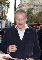 November 19 2017, PARIS FRANCE<br /> Arrival of the film team at the Premiere of<br /> Paddington 2 at UGC Normandie on avenue des Champs-Elysées Paris. The Actor Hugh<br /> Bonneville signs autographs.