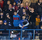 Lawrie the bagpiper plays a lament on the 54th minute after the death of Rangers fan Rab Learmonth at the last home game