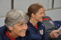 Pia Sundhage and Hege Riise on the bench at the US vs Norway game during the 2010 Algarve.