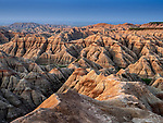 Expansive view from the Burns Basin Overlook of the badlands characteristic in the Badlands National Park, South Dakota, USA