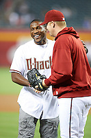 Arizona Diamondbacks guest Patrick Peterson #21 of the Arizona Cardinals after throwing out a first pitch with J.J. Putz before a National League regular season game against the Colorado Rockies at Chase Field on October 2, 2012 in Phoenix, Arizona. Arizona defeated Colorado 5-3. (Mike Janes/Four Seam Images)