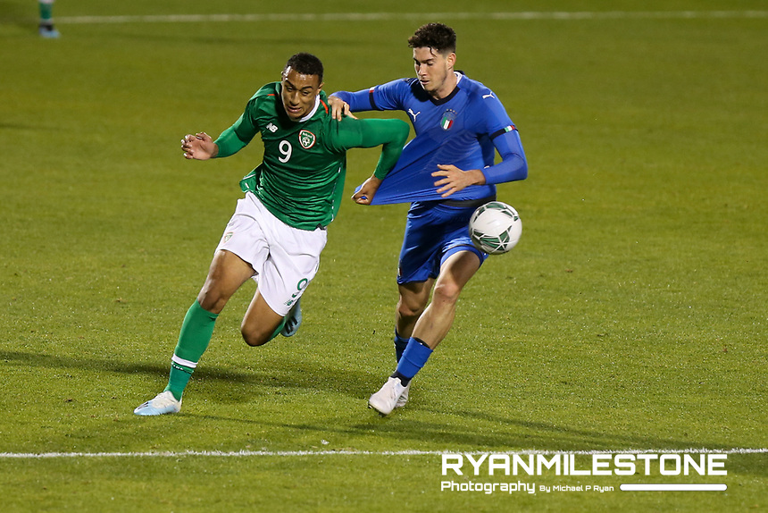 EVENT:<br /> UEFA European U21 Championship Qualifier Group 1 Republic of Ireland v Italy<br /> Thursday 10th October 2019,<br /> Tallaght Stadium, Dublin<br /> <br /> CAPTION:<br /> Adam Idah of Republic of Ireland in action against Alessandro Bastoni of Italy<br /> <br /> Photo By: Michael P Ryan