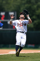 GCL Braves first baseman Ian Hagenmiller (32) catches a foul ball pop up during a game against the GCL Blue Jays on June 27, 2014 at the ESPN Wide World of Sports in Orlando, Florida.  GCL Braves defeated GCL Blue Jays 10-9.  (Mike Janes/Four Seam Images)