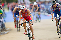 15 SEP 2013 - LONDON, GBR - Javier Gomez (ESP) (left) of Spain exits transition for the start of the bike during the elite men's ITU 2013 World Triathlon Series Grand Final in Hyde Park, London, Great Britain (PHOTO COPYRIGHT © 2013 NIGEL FARROW, ALL RIGHTS RESERVED)