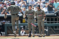Vanderbilt Commodores JJ Bleday (51) and Julian Infante (22) look on as third baseman Austin Martin (16) crosses the plate after hitting his second home run in Game 3 of the NCAA College World Series against the Louisville Cardinals on June 16, 2019 at TD Ameritrade Park in Omaha, Nebraska. Vanderbilt defeated Louisville 3-1. (Andrew Woolley/Four Seam Images)