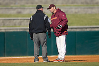 Virginia Tech Hokies head coach Pete Hughes #19 argues a call with third base umpire Danny Everett at English Field March 27, 2010, in Blacksburg, Virginia.  Photo by Brian Westerholt / Four Seam Images