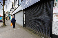 Pictured: A row of cafes and restaurants with their shutters down in the Uplands area in Swansea, Wales, UK. Saturday 21 March 2020<br /> Re: Covid-19 Coronavirus pandemic, UK.