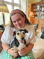 BNPS.co.uk (01202) 558833<br /> Pic BNPS<br /> <br /> PICTURED TODAY: Reunited, Tallulah Covell with Crumpet<br /> <br /> A family left devastated when their puppy went missing are shocked to have been reunited with her - more than 11 years later. <br /> <br /> Sarah Covell and her two young daughters were heartbroken when their three-month-old Jack Russell called Crumpet went missing from their back garden in 2010.<br /> <br /> They spent weeks looking for her before giving up hope of ever seeing her again.<br /> <br /> But he family received a phone call out of the blue to say their microchipped dog had been found over 30 miles away.