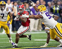ATLANTA, GA - DECEMBER 7: Brian Herrien #35 of the Georgia Bulldogs tries to avoid a tackle by Rashard Lawrence #90 of the LSU Tigers during a game between Georgia Bulldogs and LSU Tigers at Mercedes Benz Stadium on December 7, 2019 in Atlanta, Georgia.