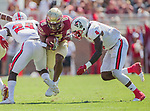 Florida State wide receiver Nyqwan Murray tries to get between North Carolina State defender Shawn Boone (24) and Jerod Fernandez in the first half of an NCAA college football game in Tallahassee, Fla., Saturday, Sept. 23, 2017.  (AP Photo/Mark Wallheiser)