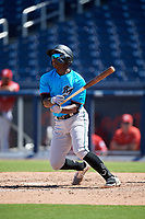 Miami Marlins Osiris Johnson (56) at bat during an Instructional League game against the Washington Nationals on September 26, 2019 at FITTEAM Ballpark of The Palm Beaches in Palm Beach, Florida.  (Mike Janes/Four Seam Images)