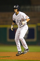 Rick Hauge #11 of the Rice Owls takes his lead off of first base versus the UCLA Bruins in the 2009 Houston College Classic at Minute Maid Park February 27, 2009 in Houston, TX.  The Owls defeated the Bruins 5-4 in 10 innings. (Photo by Brian Westerholt / Four Seam Images)