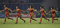 Members of the Chinese team salute the crowd after their first round game at the 2007 FIFA Women's World Cup at Wuhan Sports Center Stadium in Wuhan, China.  China defeated Denmark, 3-2.