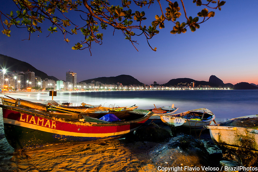 Sunrise at Copacabana beach, Rio de Janeiro, Brazil. Copacabana beach stretches from Posto Dois (lifeguard watchtower Two) to Posto Seis (lifeguard watchtower Six), where this picture was take. There are historic forts at both ends of the beach; Fort Copacabana, built in 1914, is at the south end by Posto Seis where there is a small fishing village and Fort Duque de Caxias, built in 1779, at the north end. One curiosity is that the lifeguard watchtower of Posto Seis never existed.