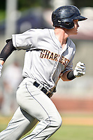 Charleston RiverDogs shortstop Kyle Holder (4) runs to first during game one of a double header against the Asheville Tourists at McCormick Field on July 8, 2016 in Asheville, North Carolina. The RiverDogs defeated the Tourists 10-4 in game one. (Tony Farlow/Four Seam Images)