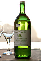 View of a bottle of 2008 Gruner Veltiner Berger white wine with a crown cap.