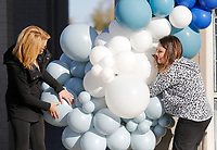 Business partners Marisa Scott (right) and Nikki Lee, with Confetti NWA of Fayetteville, suspend a large balloon garland Tuesday, November 17, 2020, on the storefront of Linden's Jewelry. Linden's is celebrating a grand re-opening after relocating their store from Bella Vista to Bentonville. Check out nwaonline.com/201118Daily/ and nwadg.com/photos for a photo gallery.(NWA Democrat-Gazette/David Gottschalk)