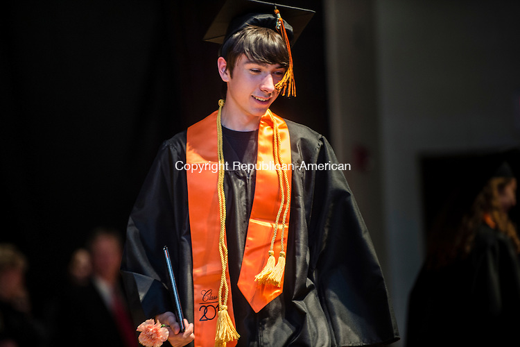TERRYVILLE, CT- 8 June 2016-060816EC08-  Student David Tyler Betters receives his diploma during Terryville High School's graduation Wednesday night. Erin Covey Republican-American