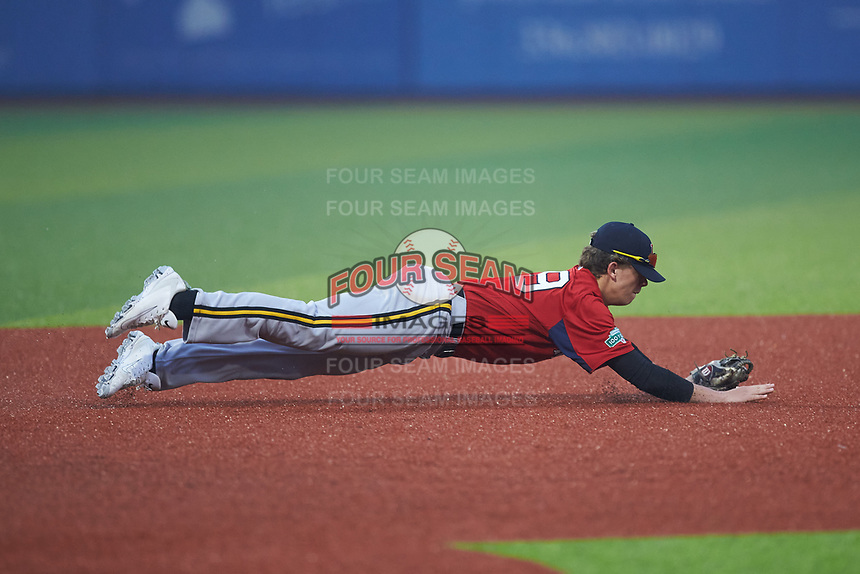 Third baseman Dylan Smith of Cleveland High School (NC) playing for the Red Sox scout team makes a diving stop during the South Atlantic Border Battle Futures Game at Truist Point on September 25, 2020 in High Pont, NC. (Brian Westerholt/Four Seam Images)