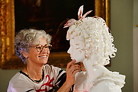 """BNPS.co.uk (01202 558833)<br /> Pic: ZacharyCulpin/BNPS<br /> <br /> Even the models hair was created out of paper.<br /> <br /> Ori-garments -  Artist Denise Watson has created a stunning 1750's masquerade Christmas Ball with characters made entirely from paper at the National Trust's Uppark House in West Sussex.<br /> <br /> Denise has dressed 14 shop mannequins with clothes, shoes, masks, fans, floral details, hair and even jewellery made from things like tissue paper, gift wrap and brown parcel paper. <br /> <br /> The festive display was inspired by Admiral Lord Gambier's memoirs in which he quotes from Lady Sarah Featherstonhaugh's journal of 1753 where she wrote: """" The whole party afterwards proceed to Uppark, where they passed a cheerful happy Christmas in the most friendly society, and enlivened their neighbourhood with some masked balls.""""<br />  <br /> The design to the finished result took a total of three months. Denise said, """"I am really delighted with the final result. It has been a joy to work at Uppark using the grand rooms and to recreate an event which actually took place""""."""