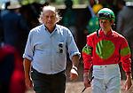Trainer Tom Voss (L) in the paddock on Delaware Handicap Day at Delaware Park in Stanton, Delware on July 16, 2011.