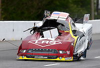 May 17, 2014; Commerce, GA, USA; Detailed view to damage to the car of NHRA funny car driver Tim Wilkerson after exploding an engine during qualifying for the Southern Nationals at Atlanta Dragway. Wilkerson would be uninjured in the explosion. Mandatory Credit: Mark J. Rebilas-USA TODAY Sports