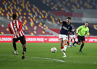 9th January 2021; Brentford Community Stadium, London, England; English FA Cup Football, Brentford FC versus Middlesbrough; Lewis Wing of Middlesbrough taking a shot past Ethan Pinnock of Brentford
