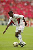 DaMarcus Beasley dribbles the ball. The USA tied South Korea, 1-1, during the FIFA World Cup 2002 in Daegu, Korea.