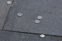 Pictured: The coins tossed to the pavement in protest to Greek Prime Minister Alexis Tsipras outside the Hellenic Centre in London, UK. Monday 25 June 2018<br /> Re: Greek Prime Minister Alexis Tsipras is on a three day visit to London, UK.