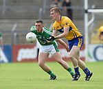 Pearse Lillis of Clare in action against Peter Nash of Limerick during their Munster championship quarter-final game in Cusack park. Photograph by John Kelly.