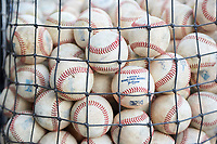 A basket of Minor League baseballs rests in the dugout before a Pioneer League game against the Grand Junction Rockies at Dehler Park on August 15, 2019 in Billings, Montana. Billings defeated Grand Junction 11-2. (Zachary Lucy/Four Seam Images)