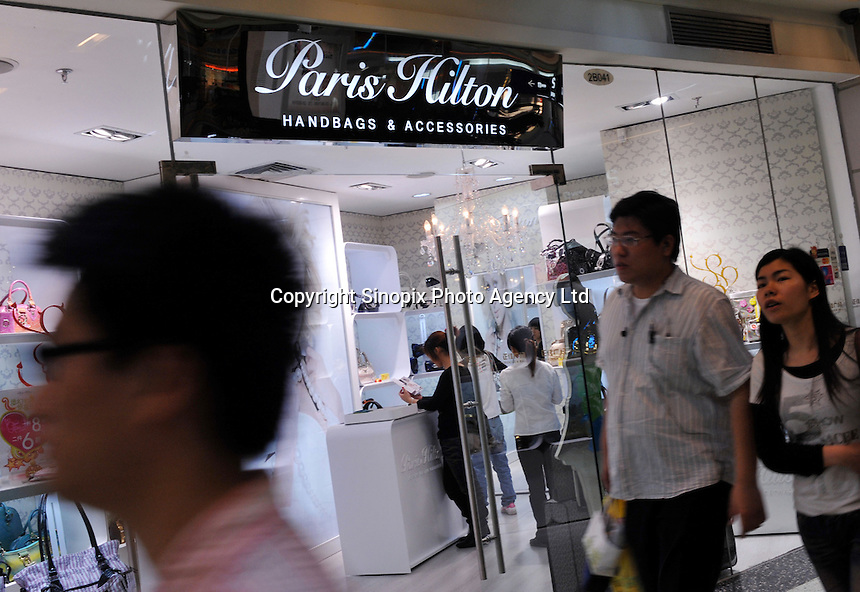 Consumers walk pass Paris Hilton store in Grand View Plaza, Guangzhou, Guangdong Province, China. Despite the general economic down-turn China's domestic demand is helping China to maintain positive economic growth..24 Apr 2009