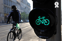 Biker by a green bicycle traffic light (Licence this image exclusively with Getty: http://www.gettyimages.com/detail/84430633 )