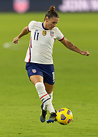 ORLANDO, FL - JANUARY 22: Ali Krieger #11 passes the ball during a game between Colombia and USWNT at Exploria stadium on January 22, 2021 in Orlando, Florida.