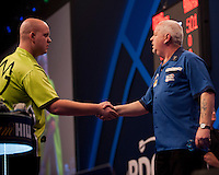 01.01.2014.  London, England.  William Hill World Darts Championship.  Quarter Final Round.  Michael van Gerwen (1) [NED] shakes hands with Robert Thornton (9) [SCO] before their  quarter final match.