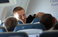 Wednesday 26 February 2014<br /> Pictured: Head coach Garry Monk on the aeroplane en route to Napoli.<br /> Re: Swansea City FC travel to Italy for their UEFA Europa League game against Napoli.