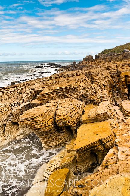 Tourists exploring limestone formations in Punakaiki - Paparoa National Park, West Coast, New Zealand
