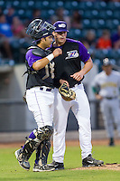 Winston-Salem Dash catcher Omar Narvaez (21) has a chat with starting pitcher Carlos Rodon (26) during the game against the Lynchburg Hillcats at BB&T Ballpark on August 13, 2014 in Winston-Salem, North Carolina.  The Hillcats defeated the Dash 4-3.   (Brian Westerholt/Four Seam Images)