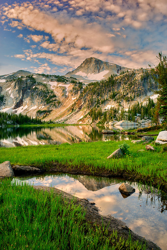 Evening light and reflection in small stream and Mirror Lake with Eagle Cap Mountain. Eagle Cap Wilderness, Oregon
